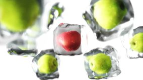 Apples in ice cubes. Food and broadcast concept. Realistic ice materials. 3d rendering. Apples in ice cubes. Food and broadcast concept. Realistic ice materials Royalty Free Stock Photos