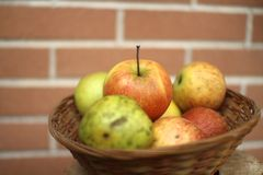 Apples inside a basket Stock Photo