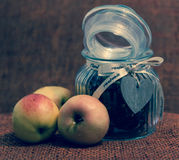Apples and jar with candy Royalty Free Stock Image