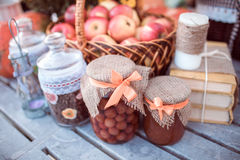 Apples, jars, jams and books Stock Photo
