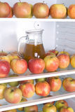 Apples with jug Stock Images