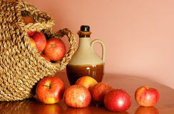 Apples and jug of cider Royalty Free Stock Photography