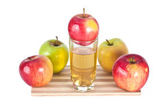 Apples and juice composition. Apples and glass of  juice composition on cutting board Royalty Free Stock Images