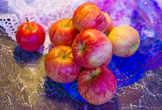 Apples on lace_2 Stock Photos