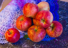 Apples on lace Royalty Free Stock Image