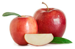 Apples with leaves and half an apple. Red apples with green leaves and half an apple on the white background Stock Images
