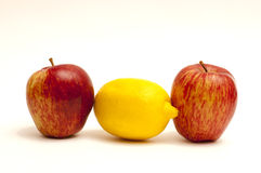 2 apples and 1 lemon on white. Fruit composition: 2 apples and 1 lemon on a white background Royalty Free Stock Photos