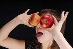 Apples like eyes. Woman with apple near her eyes Royalty Free Stock Photography