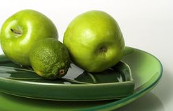 Apples and lime. S royalty free stock photo