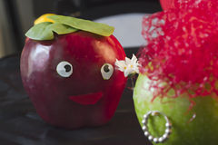 Apples in Love. Red Apple gives flower to Green Apple Stock Image