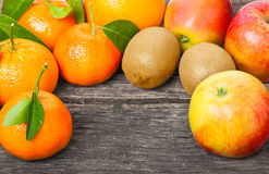 Apples, mandarin oranges, kiwis. Apples, mandarin oranges and kiwis royalty free stock photos