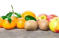 Apples, mandarin oranges, kiwis. Apples, mandarin oranges and kiwis royalty free stock images