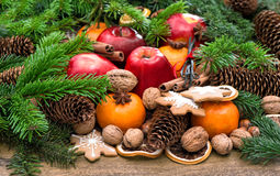 Apples, mandarine fruits, walnuts, cookies and spices Royalty Free Stock Image