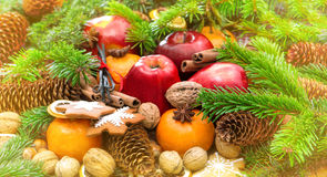 Apples, mandarine fruits, walnuts, cookies and spices Stock Photography