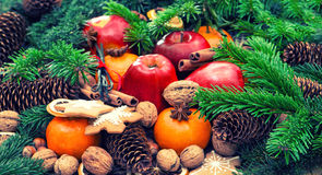 Apples, mandarine fruits, walnuts, cookies and spices Royalty Free Stock Photography