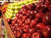 Apples At The Market. A row of stacked apples at the market Royalty Free Stock Images