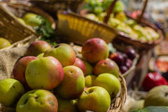 Apples at the market. Some apple in a wicker basket in a Tuscany market Stock Photos
