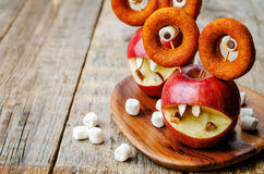 Apples, marshmallows and donuts in the shape of monsters for Hal Stock Photography