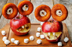 Apples, marshmallows and donuts in the shape of monsters for Hal Stock Image