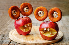 Apples, marshmallows and donuts in the shape of monsters for Hal Stock Photo