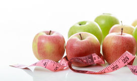 Apples and measure tape on white background Stock Photo