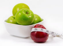 Apples and measuring tape Stock Photos