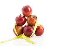 Apples and measuring tape Stock Photography