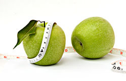 Apples with measuring tape. Isolated on white background Royalty Free Stock Images