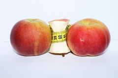 Apples with measuring tape Stock Photography