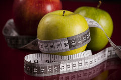 Apples with measuring tape Royalty Free Stock Photo