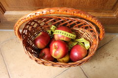 Apples with measuring tape Stock Photo
