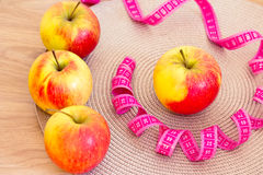Apples and measuring tape: fat loss Stock Photos