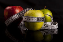 Apples with measuring tape Stock Images