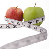 Apples and measuring tape - health. Stock Images