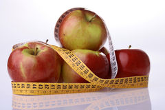Apples and measuring tape Royalty Free Stock Image