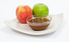 Apples with melted caramel Stock Photography