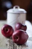 Apples and milk pail Stock Photo