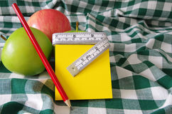 Apples and note pad Royalty Free Stock Image