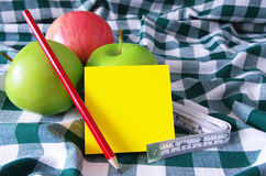 Apples note pad and pencil Stock Photography