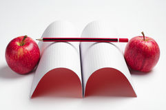 Apples, notebook and pencil Stock Photography