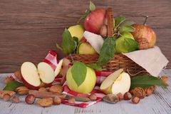Apples and nuts in basket Stock Photo