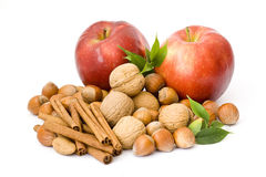 Apples, nuts and cinnamon Royalty Free Stock Photography