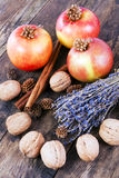 Apples, nuts and cinnamon on wooden board. Stock Images
