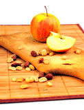 Apples and nuts on a cutting board Stock Photo