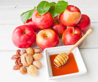 Apples, nuts and honey Royalty Free Stock Photography