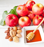 Apples, nuts and honey Royalty Free Stock Images
