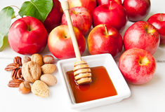 Apples, nuts and honey Stock Photography