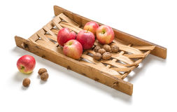 Apples and nuts on a wooden frame Stock Photography