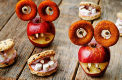 Apples and oatmeal cookies in the shape of monsters for Hallowee Stock Photo