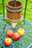 Apples with old fruit press Royalty Free Stock Images